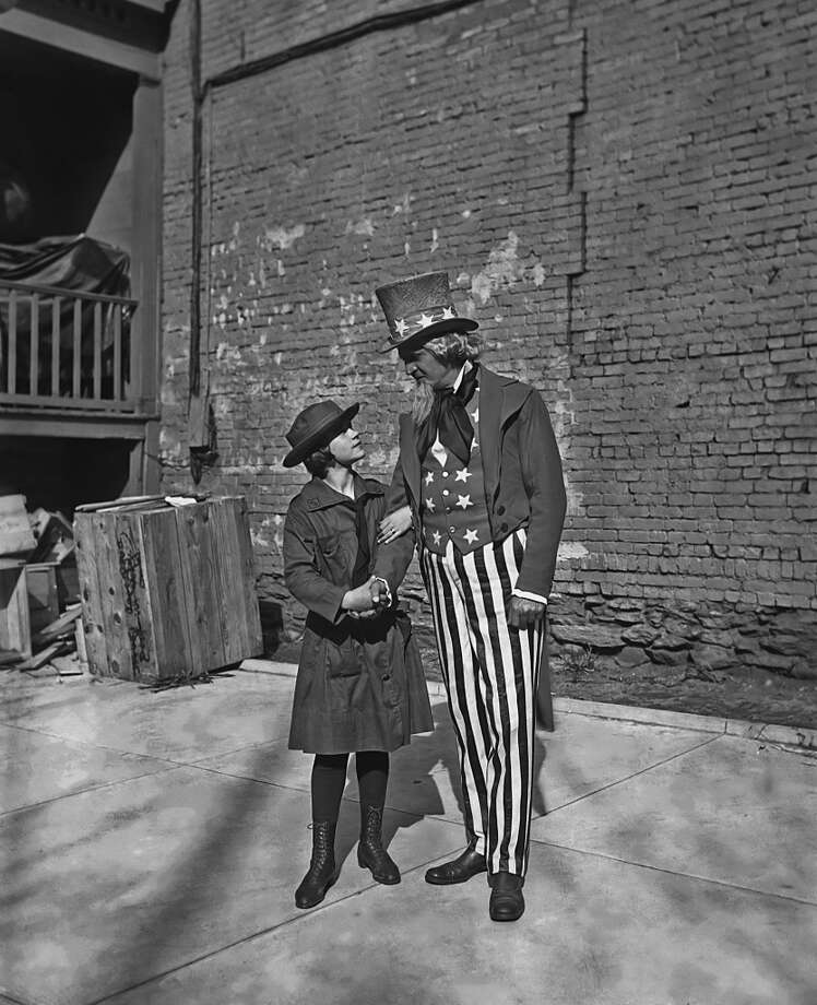 Girl Scouts don't just sell cookies. Here's a look at their activities dating back to 1914, the year this Girl Scout had her photo taken with Uncle Sam. Photo: FPG, Getty Images