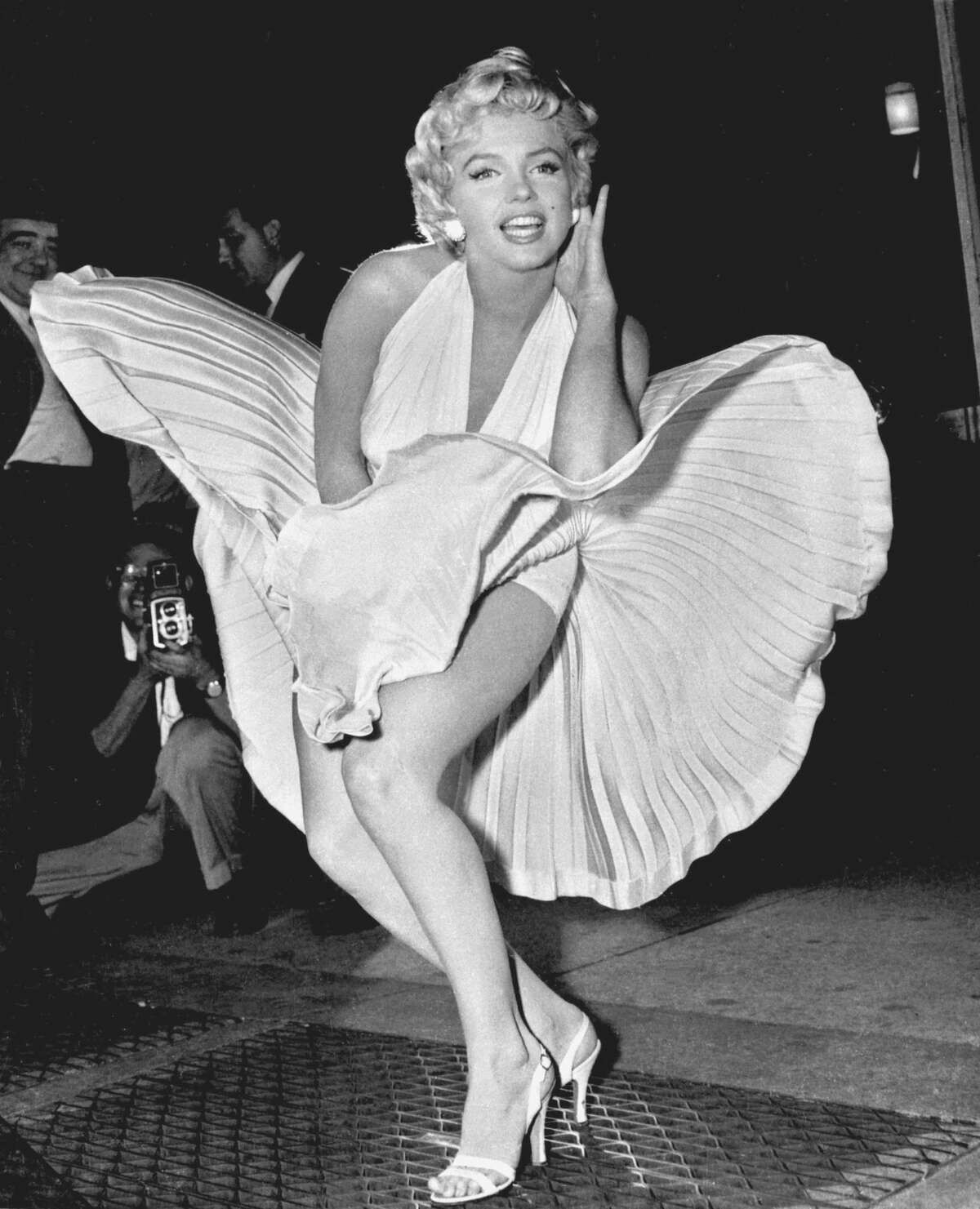 In this Sept. 9, 1954, file photo, Marilyn Monroe poses over the updraft of New York subway grating while in character for the filming of