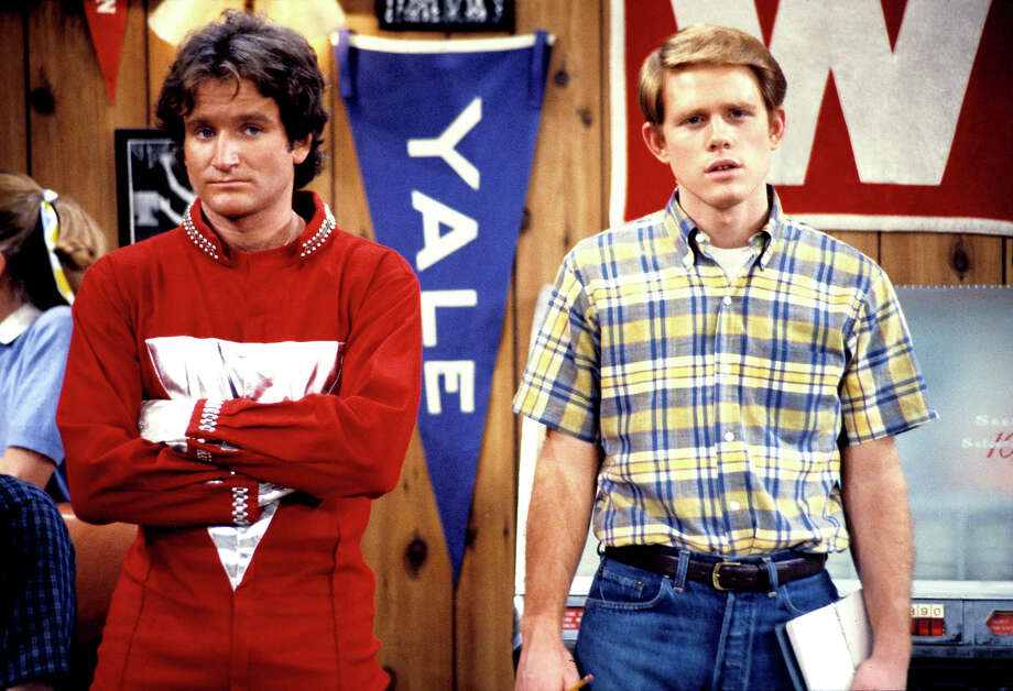 "Robin Williams as Mork from Ork and Ron Howard as Richie Cunningham in ""Happy Days."" Mork made appearances on the sitcom before spinning off as ""Mork & Mindy."" Mork came to Earth looking for a human to study and picked Richie. Photo: ABC Photo Archives, ABC Photo Archives/Getty Images / 1978 American Broadcasting Companies, Inc."
