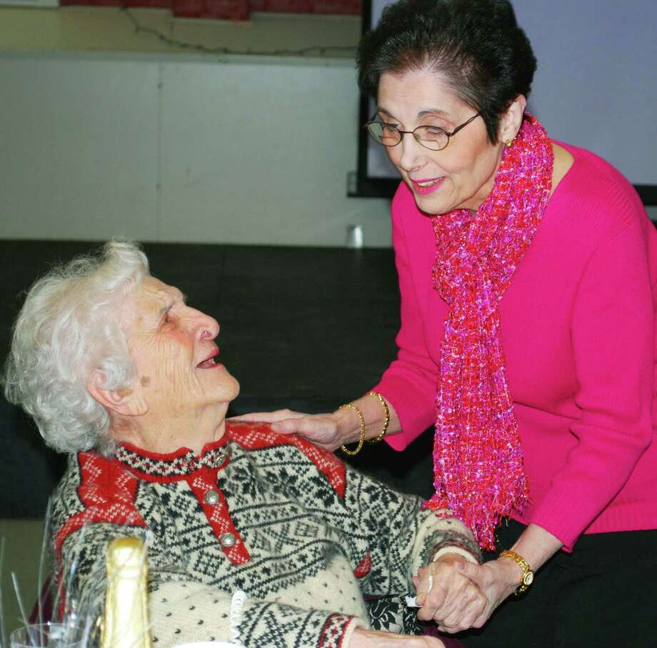Dorothea Cosentino, left, is warmly greeted by Mary Ann Sullivan during the New Milford Senior Center's New Year's part, Jan. 10, 2014, at The Maxx. Photo: Deborah Rose / The News-Times