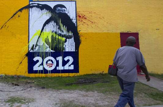 "3710 TravisGregory Garner walks past a mural painted in honor of President Barack Obama after it was vandalized Monday, Jan. 28, 2013, in Houston. ""I just don't know what to say when people do that,"" said Garner. ""It's just terrible."" Photo: Cody Duty, Houston Chronicle"