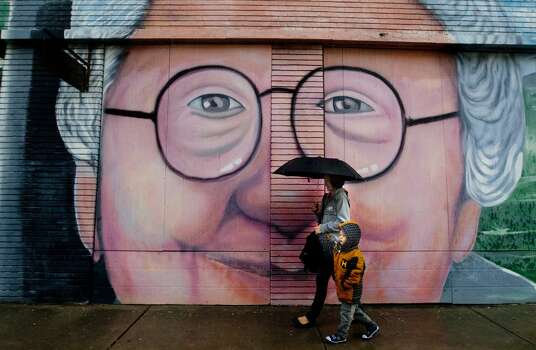 Holman StreetElly Waty walks with her son Joshua Waty in front of a mural along Holman Street, Thursday, Jan. 9, in Houston. Photo: Cody Duty, Houston Chronicle