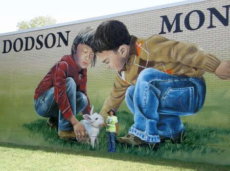 Dodson Elementary, 1808 Sampson. How big are the little kids at play in Anat Ronen's realistic mural? So big that it's easy to spot them from Interstate 45. Photo: Courtesy Anat Ronen