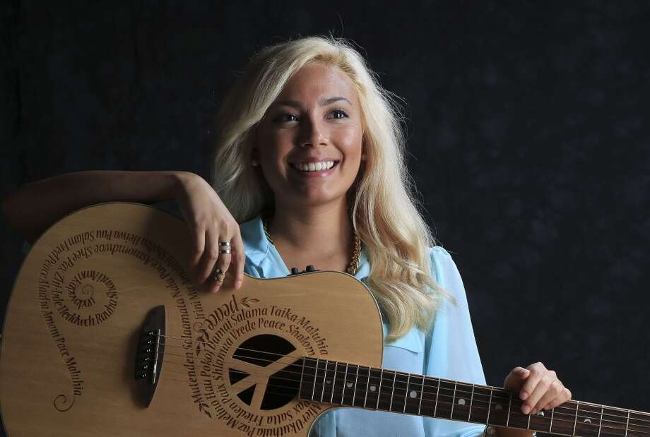 "Local country singer Arabella Jones has almost 24,000 YouTube subscribers and recently released original single ""Let's Roll."" Photo: Karen Warren, Houston Chronicle"
