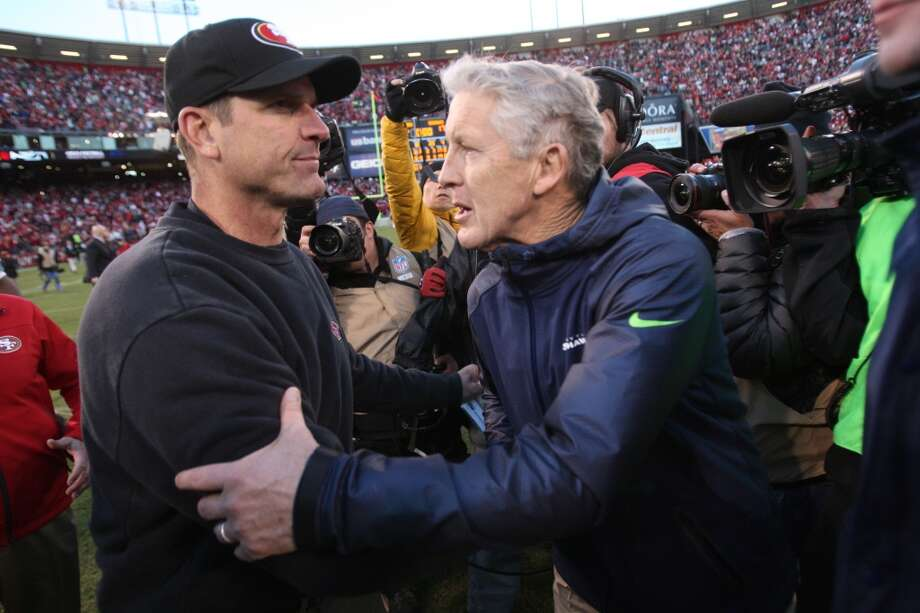 """The genesis of the Seattle vs. SF may lie with Pete Carroll vs. Jim Harbaugh.It all started back in 2009, when Seattle's Pete Carroll was at USC and S.F.'s Jim Harbaugh was at Stanford. Harbaugh's Cardinal team ran up the score on Carroll's Trojans, causing Carroll after the game to ask, """"What's your deal?"""" The dust-up lives on as one of the seeds of today's Seahawks-49ers rivalry. Photo: Michael Zagaris, Getty Images"""