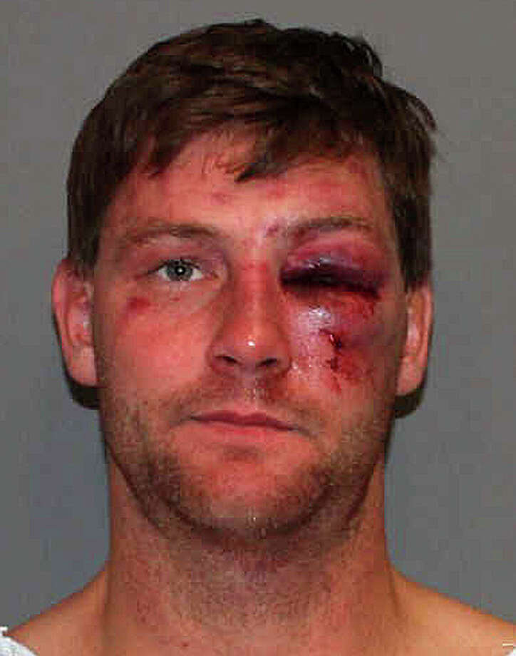 Christian Garnett, 32, an assistant Darien High School football coach, faces a series of charges after police said he was stopped while driving drunk and then fought with officers on Connecticut Avenue in Norwalk. Photo: Norwalk Police Department / Westport News contributed
