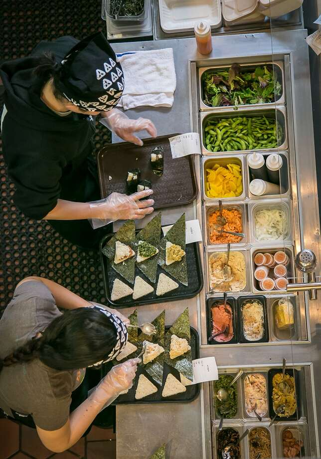 Preparing the day's offerings at Onigilly, clockwise from left; rice balls with edamame and pickles; miso soup; Seafood Classic rice bowl with miso tuna salad, spicy shrimp and seaweed. Photo: John Storey, Special To The Chronicle