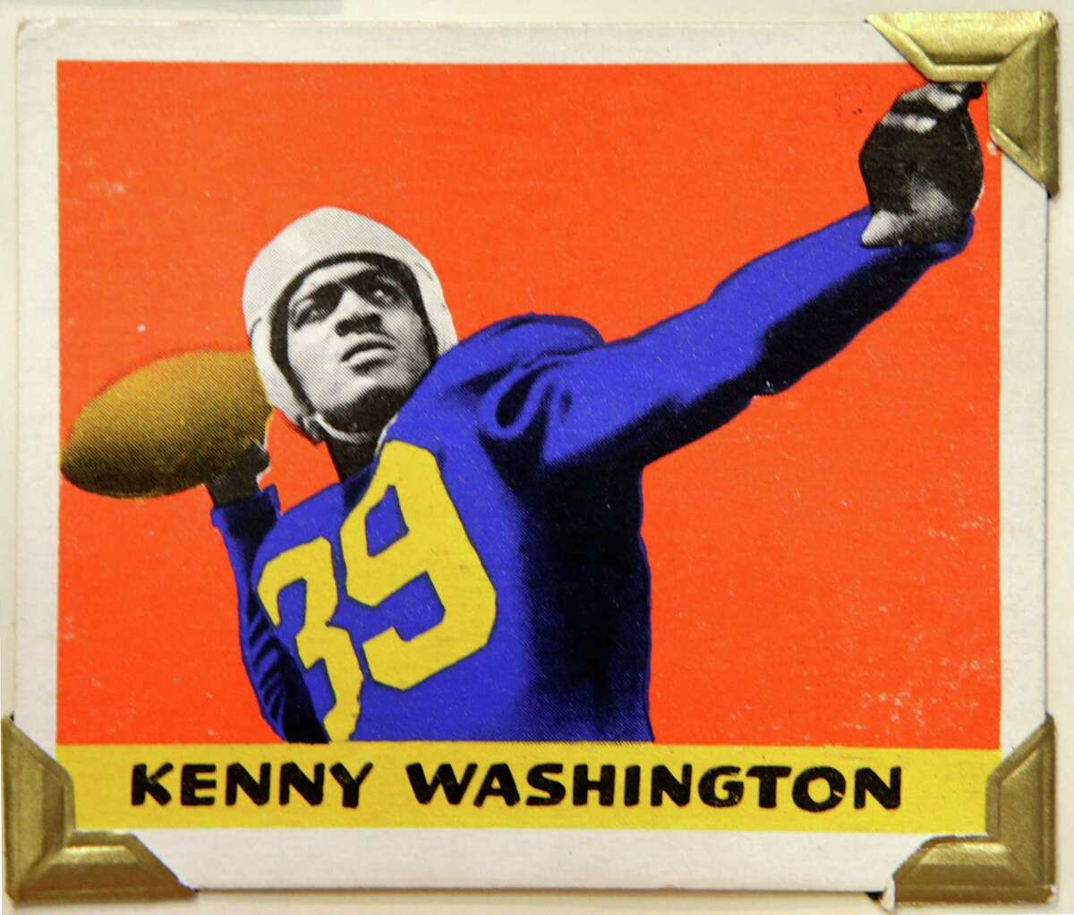 UCLA tailback and Los Angeles Rams running back Kenny Washington is shown in this 1948 Leaf Gum Company football trading card, shown Wednesday, Jan. 8, 2014, at the Metropolitan Museum of Art in New York. Washington played alongside Jackie Robinson at UCLA and in 1946 became one of the first black players in the NFL after a 12-year ban. The Met is presenting a pop-up exhibition celebrating football's history through the ages with vintage trading cards. The 150 cards, including a series from 1894, are part of approximately 600 football cards from the museum's vast collection of sport trade cards donated to the Met by the late hobby pioneer Jefferson Burdick. The exhibit runs Jan. 24 through Feb. 10. (AP Photo/Kathy Willens) ORG XMIT: NYKW107