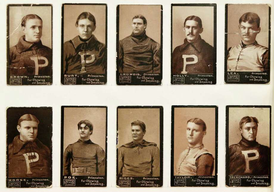 An 1894 series of football trading cards produced by the P.H. Mayo Tobacco company feature Ivy League football stars in their Princeton collegiate sweaters, shown Jan. 8, 2014, at the Metropolitan Museum of Art in New York.  The Met is presenting a pop-up exhibition celebrating football's history through the ages with vintage cards like these. The 150 cards that make up the exhibit are part of approximately 600 from the museum's vast collection of sport trade cards donated to the Met by the late hobby pioneer Jefferson Burdick. Sunday, Jan. 12, 2014, in New York. The show runs Jan. 24 through Feb. 10. (AP Photo/Kathy Willens) ORG XMIT: NYKW104 Photo: Kathy Willens, AP / AP