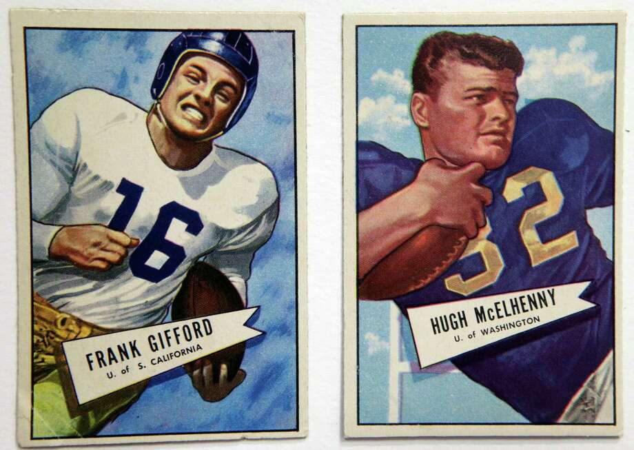 A University of Southern California 1952 card of football star Frank Gifford, the New York Giants' No. 1 draft pick, is shown Jan. 8, 2014, at the Metropolitan Museum of Art in New York. The cards are part of a pop-up exhibition at the Met celebrating football's history through the ages with vintage trading cards. The 150 cards, including a series from 1894, are part of approximately 600 cards from the museum's vast collection of sport trade cards donated to the Met by the late hobby pioneer Jefferson Burdick.  The exhibit runs Jan. 24 through Feb. 10. (AP Photo/Kathy Willens) ORG XMIT: NYKW108 Photo: Kathy Willens, AP / AP