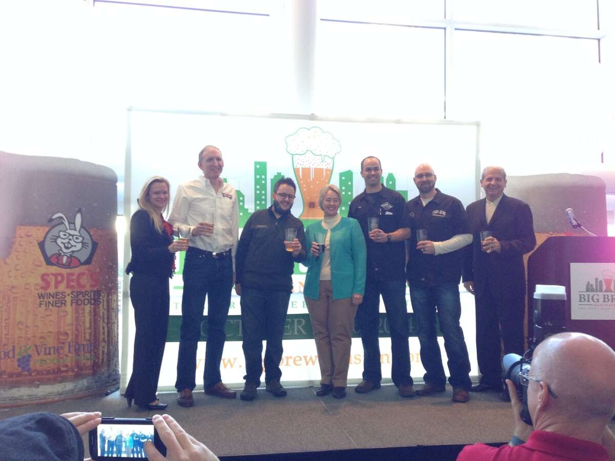 Several local craft brewers were on hand for the Big Brew announcement today at the George R. Brown Convention Center. From left, Lisa Rydman of event sponsor Spec's, Brock Wagner of Saint Arnold, David Graham of Karbach, Mayor Annise Parker, Brian Royo of No Label, Carl Norberg of Fort Bend Brewing and Clifton McDerby of Food & Vine Time Productions.