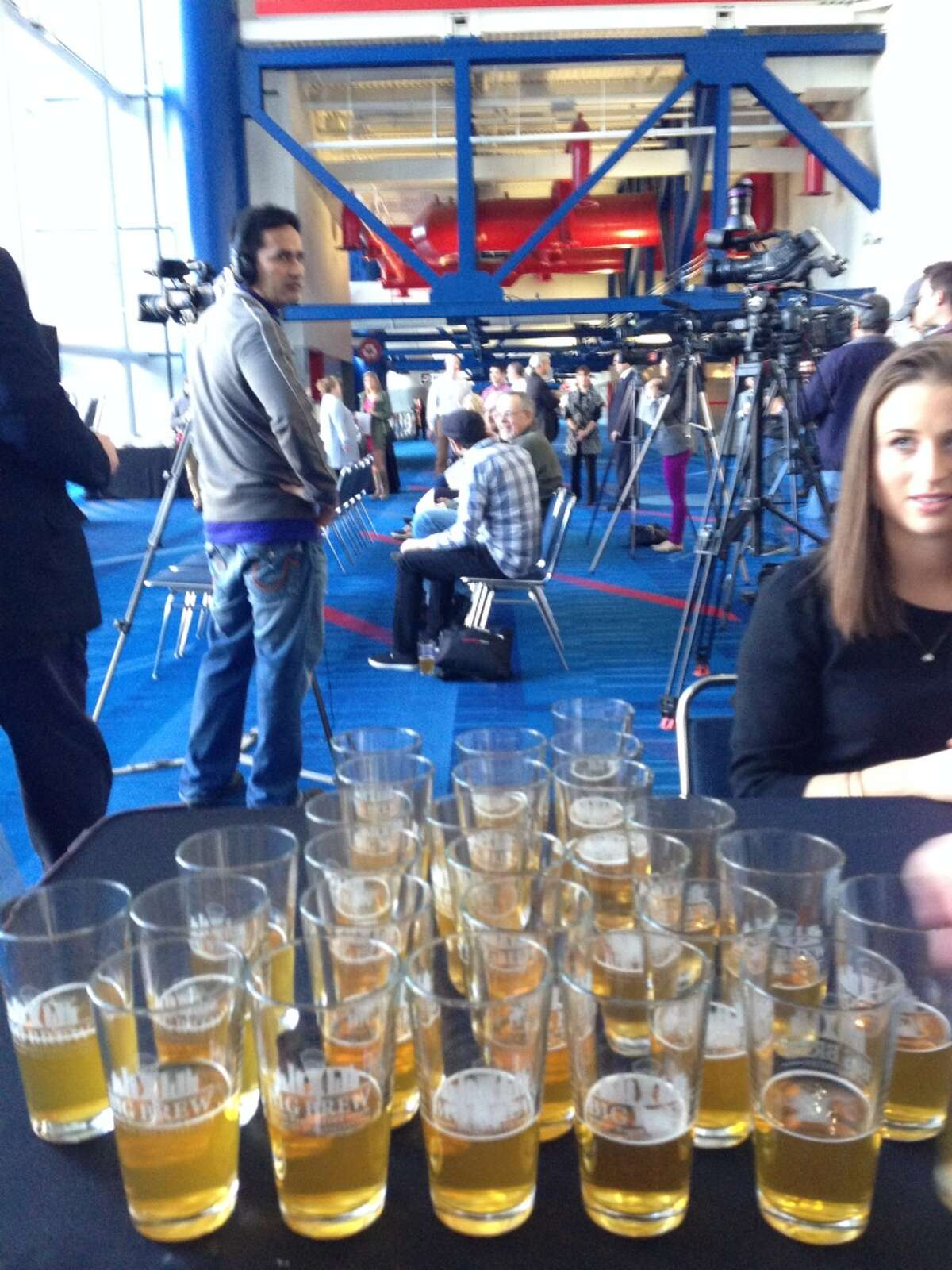 Organizers of the news conference set out glasses with Saint Arnold beer for a post-announcement toast.