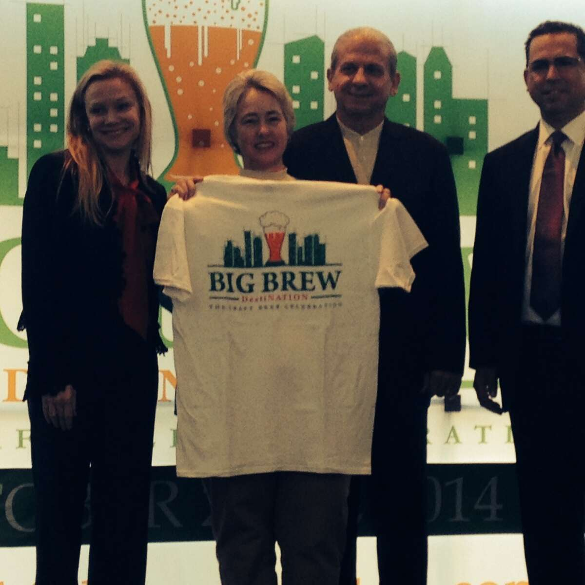 Mayor Annise Parker posed with a Big Brew T-shirt, flanked by Lisa Rydman of event sponsor Spec's and organizer Clifton McDerby of Food & Vine Time Productions.