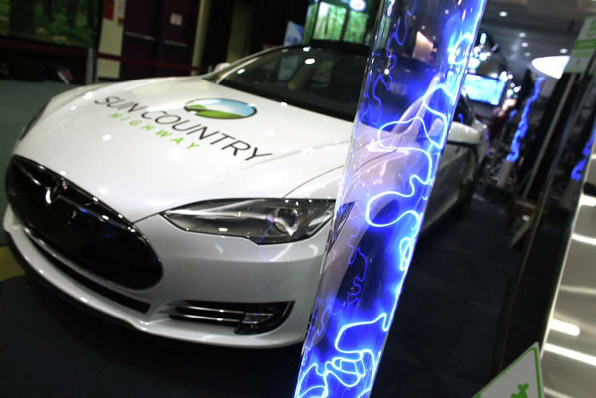 A Tesla S at the Canadian International Auto Show. A source tells The Chronicle that Apple's Adrian Perica met with Tesla CEO Elon Musk in Cupertino last spring, around the same time analysts suggested Apple acquire the electric cargiant.