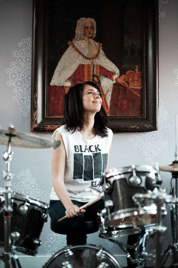 Kathleen Hanna playing the drums. Photo courtesy of Allison Michael Orenstein / Allison Michael Orenstein