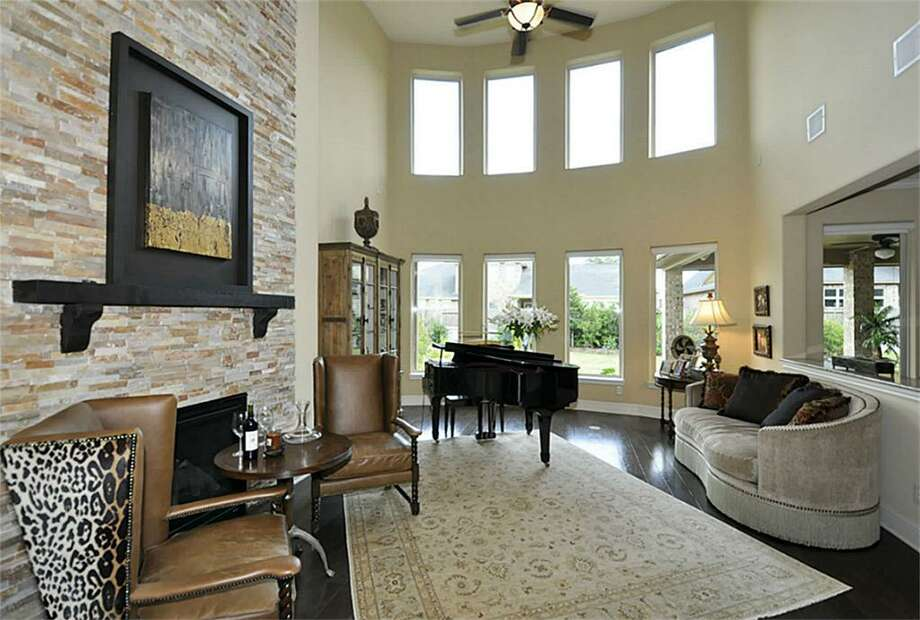 6207 N Tamarino Park: This 2012 home has 4 bedrooms, 3.5 bathrooms, and 4,773 square feet. Listed for $696,900. Photo: Houston Association Of Realtors