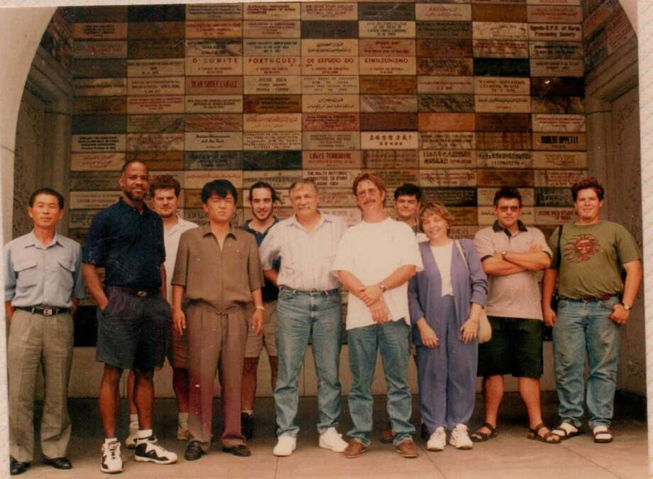 This is the base of the Juche Monument. All the plaques in the back are supposedly Juche movements from around the world showing support. We did not see an American organization. First on the left is Tiger's watcher. I am third from the left. Tiger is fourth from the left.  Captain is sixth from left.