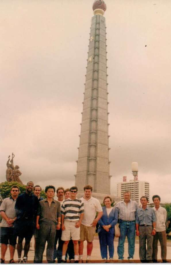 Crew in front of the Juche Monument Left to right: Venezuelan QMED. Reggie the Cook, Andy 2nd engineer, Tiger, three guys I do not remember (Deck Dept.), me, chief mate, Captain Bo, Tiger's watcher, van driver.
