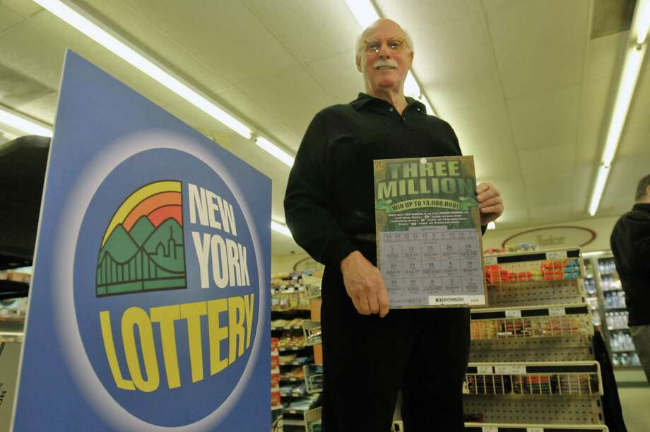 "William Bracken, of Vero Beach, Fla. poses inside the Cumberland Farms store in Greenwich following a presentation by State Lottery officials where Bracken won $3,000,000 on a Three Million scratch-off game.  Bracken was in the area back in October when he gave his son Christopher Bracken, who lives in the area, money to buy some lottery games for him.  ""I just gave him some money and said buy me five $10 tickets."" The Three Million scratch-off game winner was one of the tickets.  William Bracken is a fine art artist.    (Paul Buckowski / Times Union) Photo: Paul Buckowski / 00025356A"