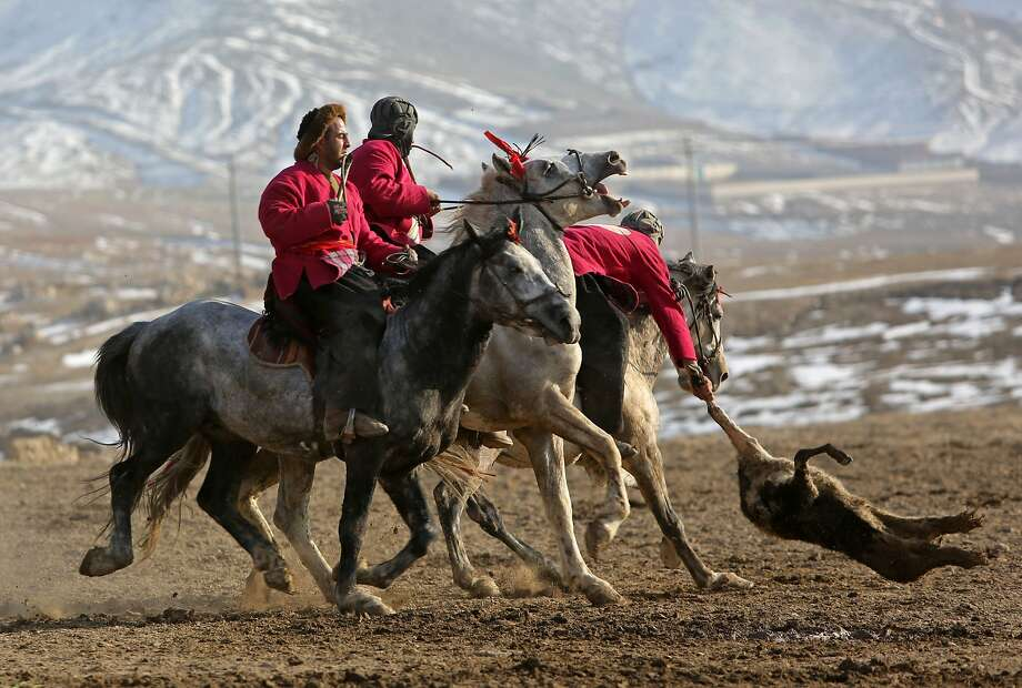 On the outskirts of Kabul, there's zero interest in the NFC Championship game, but huge interest in the goat carcass polo playoffs. Photo: Rahmat Gul, Associated Press
