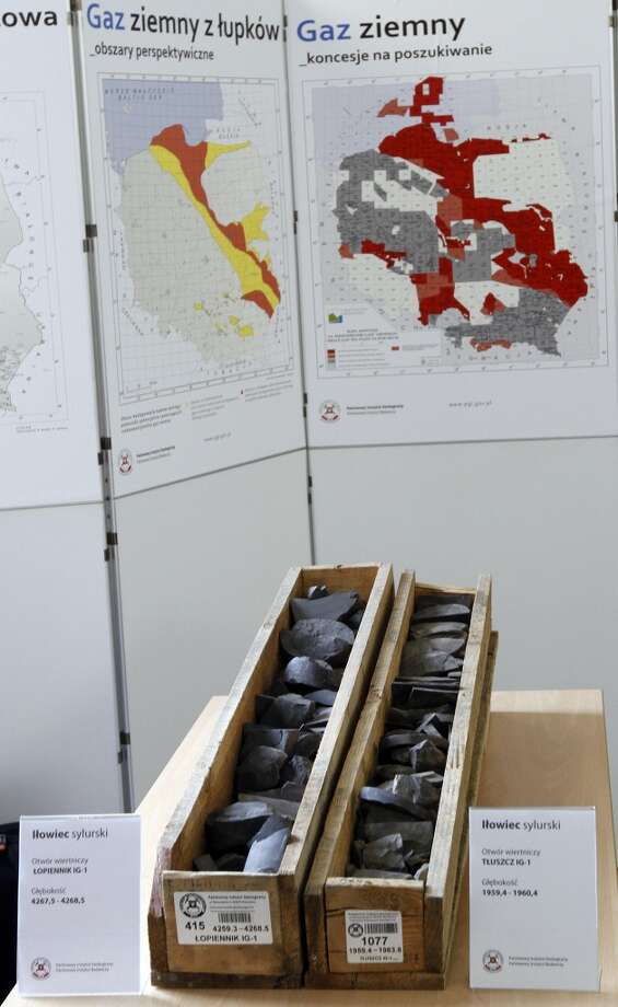 Samples of shale rocks and maps of Poland's shale gas deposits and exploration licenses are displayed at the State Geological Institute in Warsaw, Poland on Wednesday, March 21, 2012 during the presentation of the institute's report, which estimated the nation's recoverable shale gas reserves at between 346 and 768 billion cubic meters, below expectations. Poland is hoping that unconventional gas will help to break its dependence on Russian gas imports. Photo: Czarek Sokolowski, Associated Press