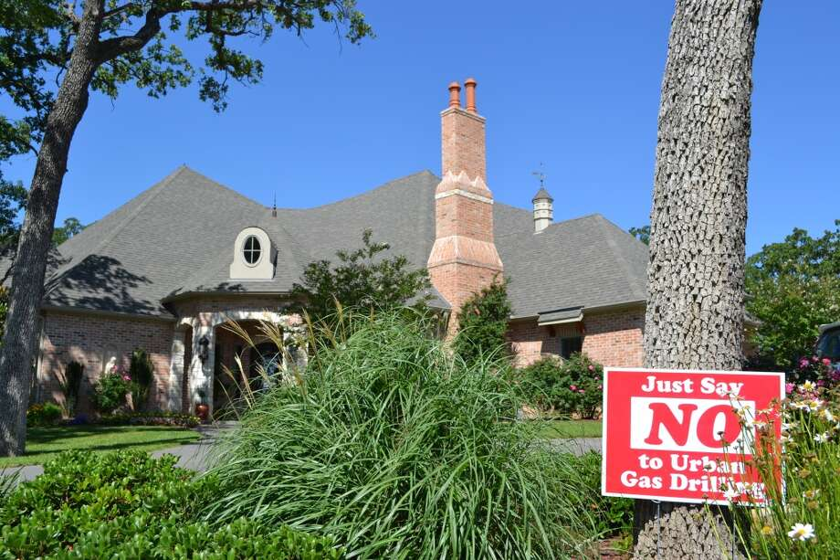 A yard sign in front of Michael and Susan Knoll's North Texas home describes their feelings toward natural-gas drilling near residential areas of the Barnett Shale. Photo: Ronnie Crocker, Houston Chronicle
