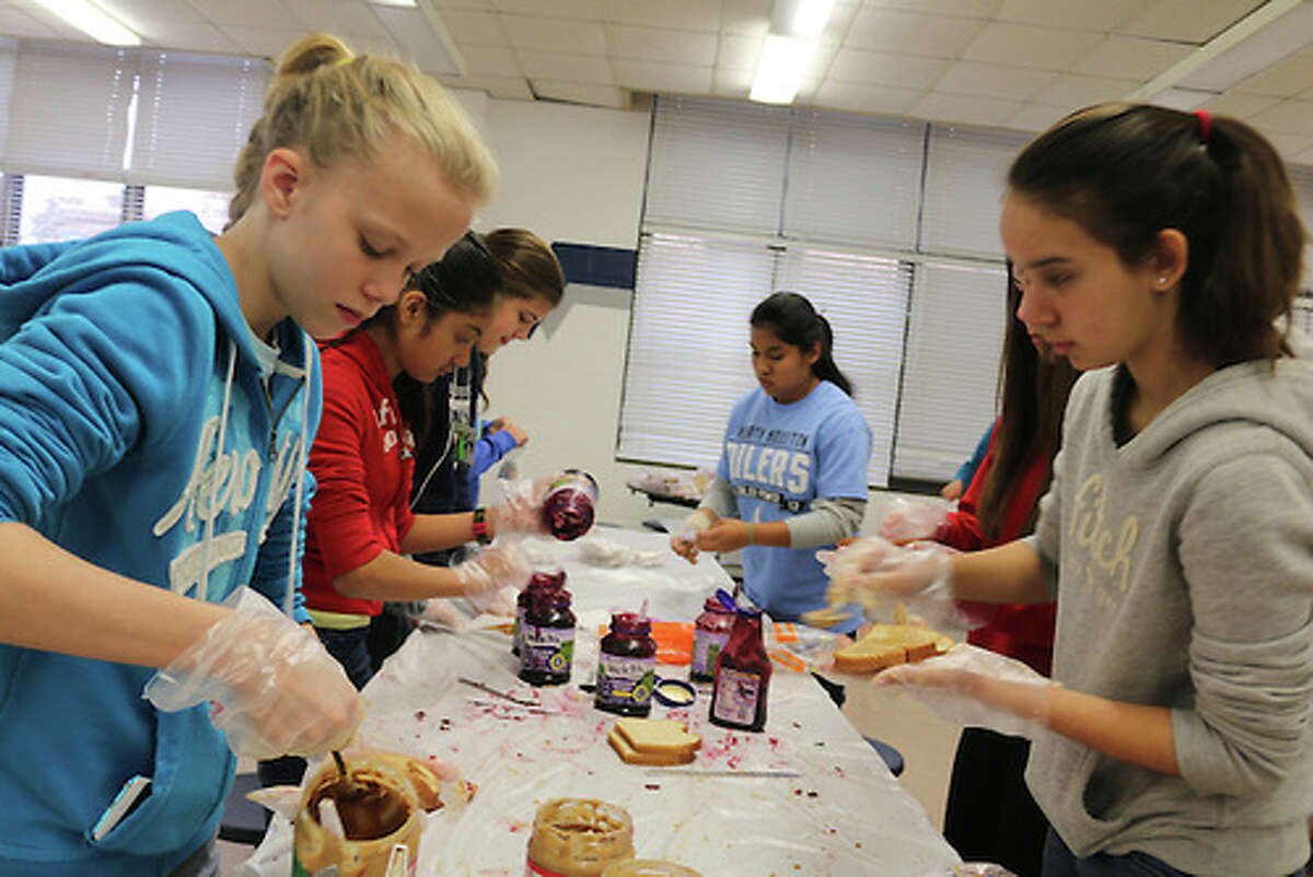 Hamilton Middle School students make sandwiches for the homeless as part of the school's partnership with the Rice University Coalition on Hunger and Homelessness, and Kids' Meals.