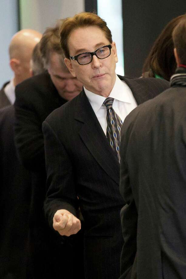 H. Ty Warner, the billionaire who created Beanie Babies, arrives at federal court for sentencing on Tuesday, Jan. 14, 2014, in Chicago. Last year Warner pleaded guilty to one count of tax evasion for hiding $25 million in income in secret Swiss bank accounts. (AP Photo/Andrew A. Nelles) ORG XMIT: ILAN101 Photo: Andrew Nelles / FR170974 AP