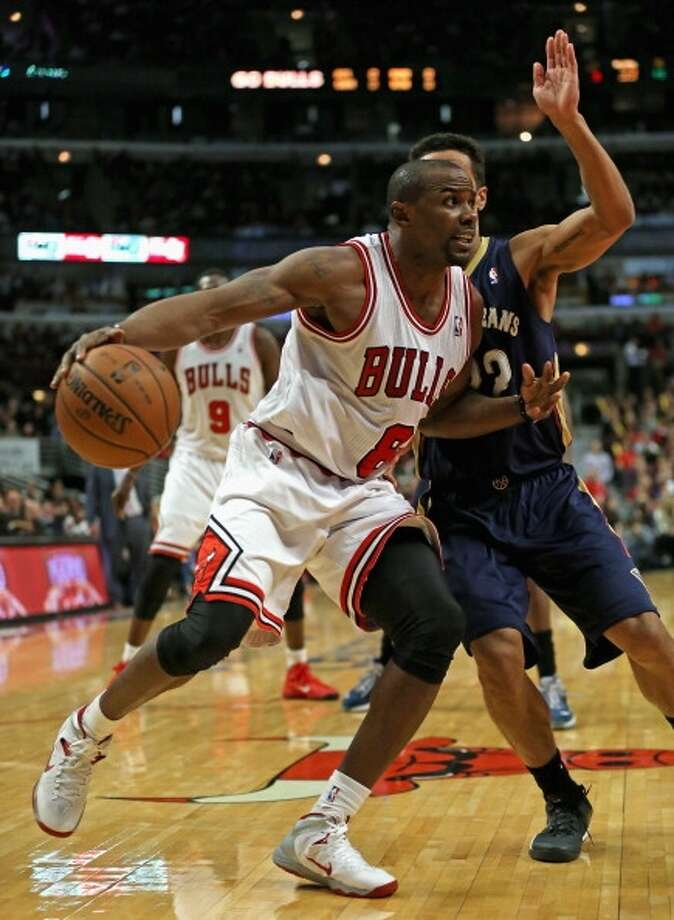 Mike James  Position: Point guard  Previous team: Chicago Bulls  Height/weight: 6-2. 188 pounds  NBA experience: 11 years  Has played on 11 different NBA teams. Photo: Jonathan Daniel, Getty Images