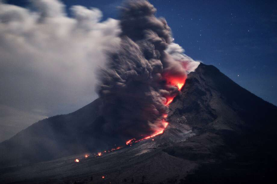 Spewing lava and hot ash,the Sinabung Volcano in Karo, North Sumatra, shows no sign of mellowing out. More than 25,000 people have fled their homes following a series of eruptions. Photo: Sutanta Aditya, AFP/Getty Images