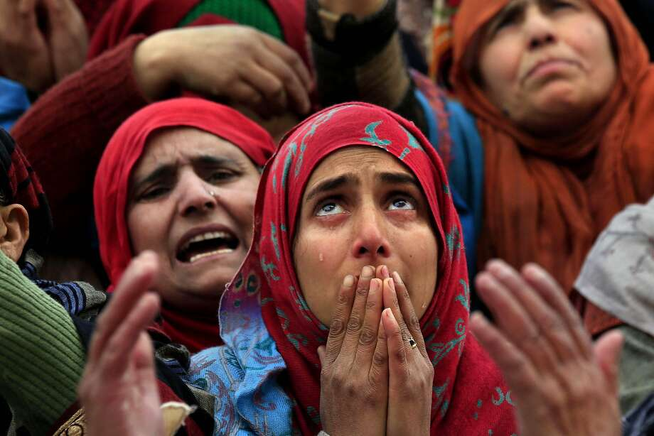 Cries and whiskers:In Srinagar, India, Kashmiri Muslim women break down in tears as they watch a priest hold what is believed to be a hair from Prophet Muhammad's beard. The relic is displayed annually at Hazratbal shrine on Eid-e-Milad, the birth anniversary of the prophet. Photo: Dar Yasin, Associated Press