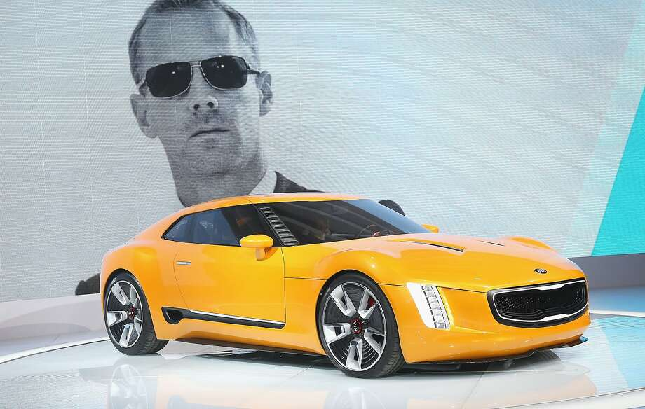 Kia GT4 Stinger concept:Kia's latest concept car forgoes an audio system, with the idea that the sound from under the hood and the exhaust will be music to the driver's ears. The four-seat GT4 Stinger made its debut in Detroit and features a version of Kia's 2.0-liter turbocharged gasoline four-cylinder engine, with a six-speed manual transmission that packs 315 horsepower. Designers gave the sports car what they described as a shrink-wrapped appearance with a bright, orange-yellow hue. Kia Motors America notes that it often ends up making vehicles that closely resemble concept versions. Photo: Scott Olson, Getty Images