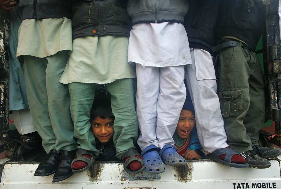 It's standing room only at a rally marking Milad-un-Nabi, a festival that commemorates the birthday of Prophet Muhammad in Katmandu, except for a couple of boys who lay down to get a better view. Photo: Niranjan Shrestha, Associated Press
