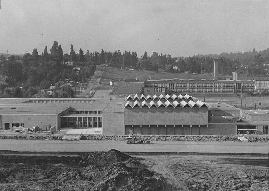 Nathan Hale High School was built on a bog-like golf course in Northeast Seattle. It's pictured on Aug. 30, 1963, soon before it opened its doors. Photo: Phil Webber, copyright MOHAI, Seattle Post-Intelligencer collection, 2000.107_print_schools_hale_001.  Photo: Copyright MOHAI