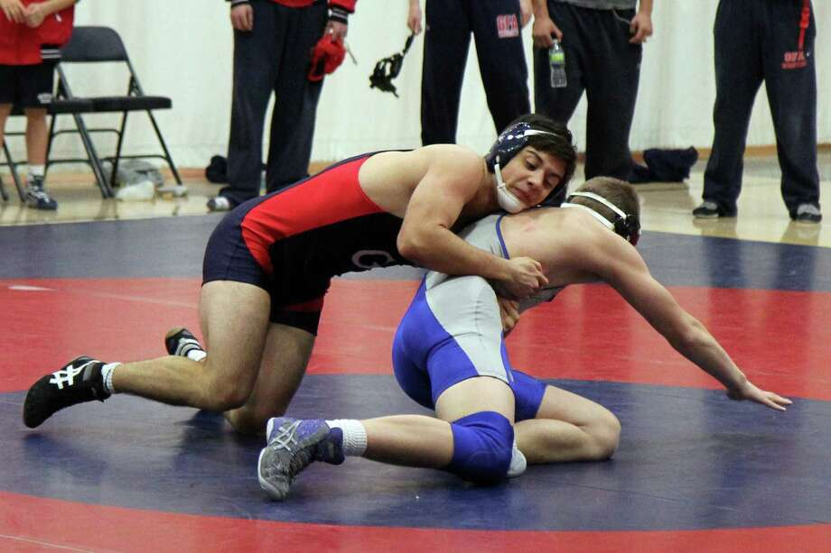 Greens Farms Academy junior Jad Qaddourah, left, pinned his opponent in the Dragons' 51-30 victory over Marianapolis Prep last week. Photo: Contributed Photo / Westport News Contributed