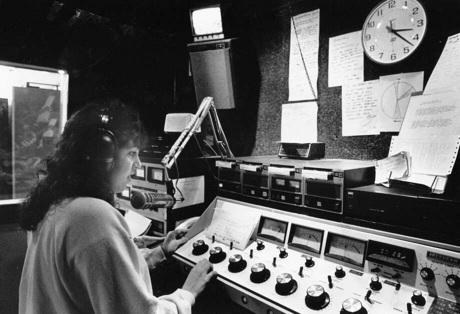 Kristy Wilson is pictured working at KNHC (C89.5FM), Nathan Hale's radio station, circa 1989. The student-run station is now so popular that it influences Billboard's dance-music charts. Photo: Jim Bates, copyright MOHAI, Seattle Post-Intelligencer collection, 2000.107_print_schools_hale_002. Photo: Copyright MOHAI
