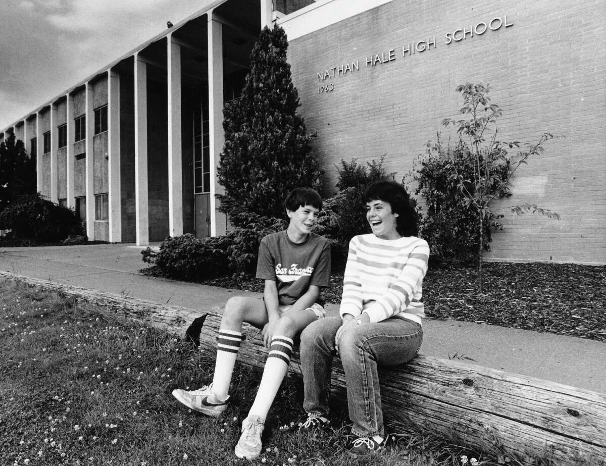 Check out those '80s socks. It's Nathan Hale High School in 1983, with students Paul and Amy Cavender (twins), then both 14, in the foreground. Photo: copyright MOHAI, Seattle Post-Intelligencer collection, 2000.107_print_schools_hale_016.
