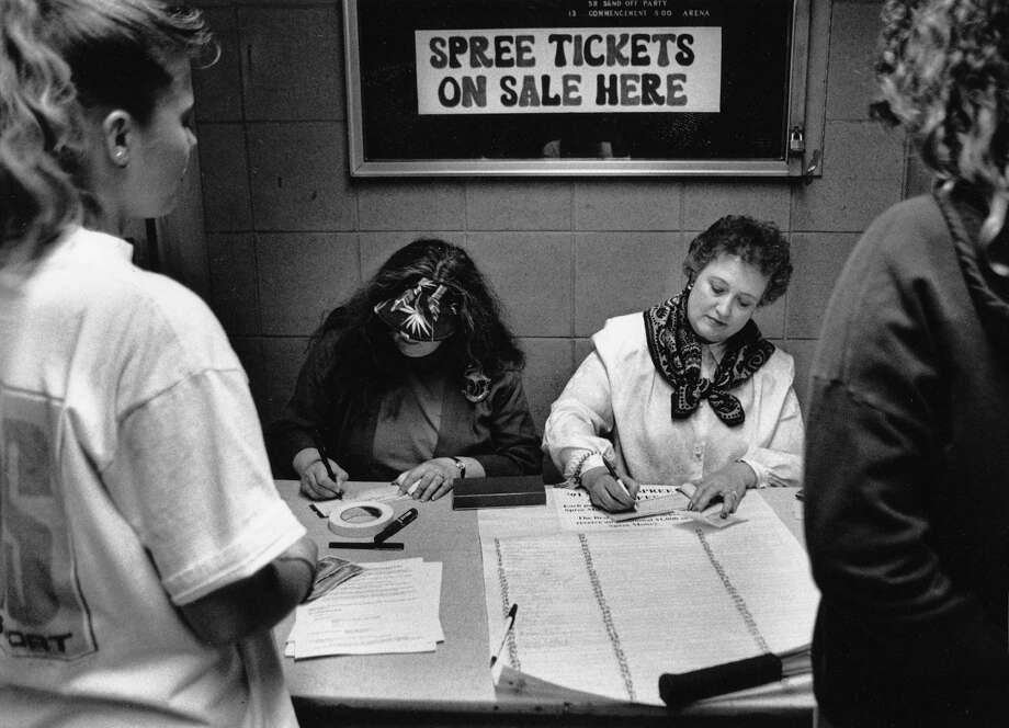 What do grad nights look like these days? Back in 1991, Nathan Hale held ''Spree'' graduation parties. Pictured are Sandra Keber, left, and Joan Overland selling Spree tickets on May 29, 1991. Photo: Mike Bainter, copyright MOHAI, Seattle Post-Intelligencer collection, 2000.107_print_schools_hale_017. Photo: Copyright MOHAI