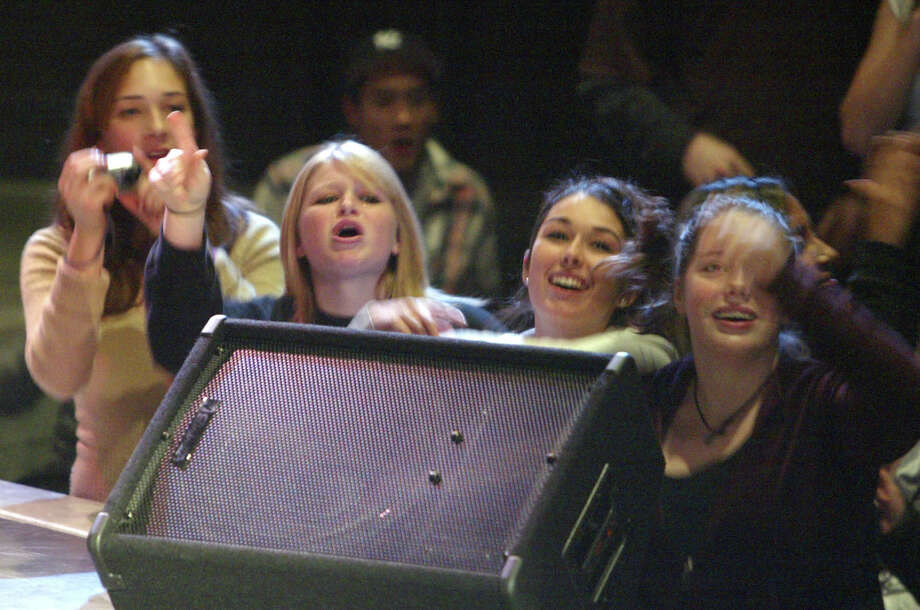 Does high school get better than this? Nathan Hale students (left to right) Caroline Tofflemire, Krissy Thorman, Mikaela Galstaun and Nathalie Springer watch Rihanna perform at their school on Dec. 5, 2005. Photo: GILBERT W. ARIAS, Copyright MOHAI / Seattle P-I