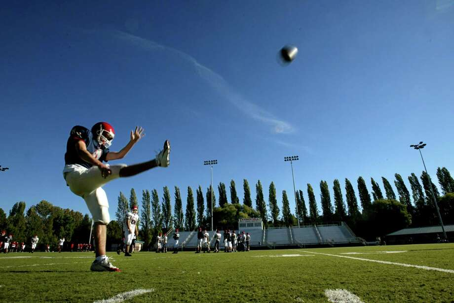 Nathan Hale's Kiel Rasp lets loose in practice on Sept. 7, 2005.  Photo: SCOTT EKLUND, Copyright MOHAI / SEATTLE POST-INTELLIGENCER