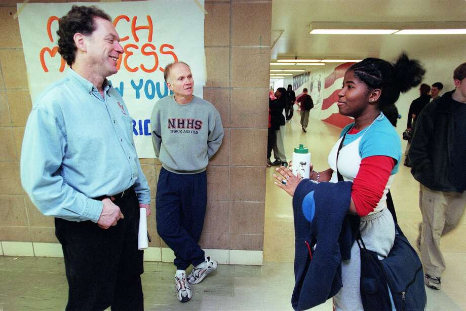 Life in the hallways: Nathan Hale vice-principal Rick Harwood, left, and principal Eric Benson, center, chat with 10th grader Catherine Harris-White in 2002.  Photo: PAUL JOSEPH BROWN, Copyright MOHAI