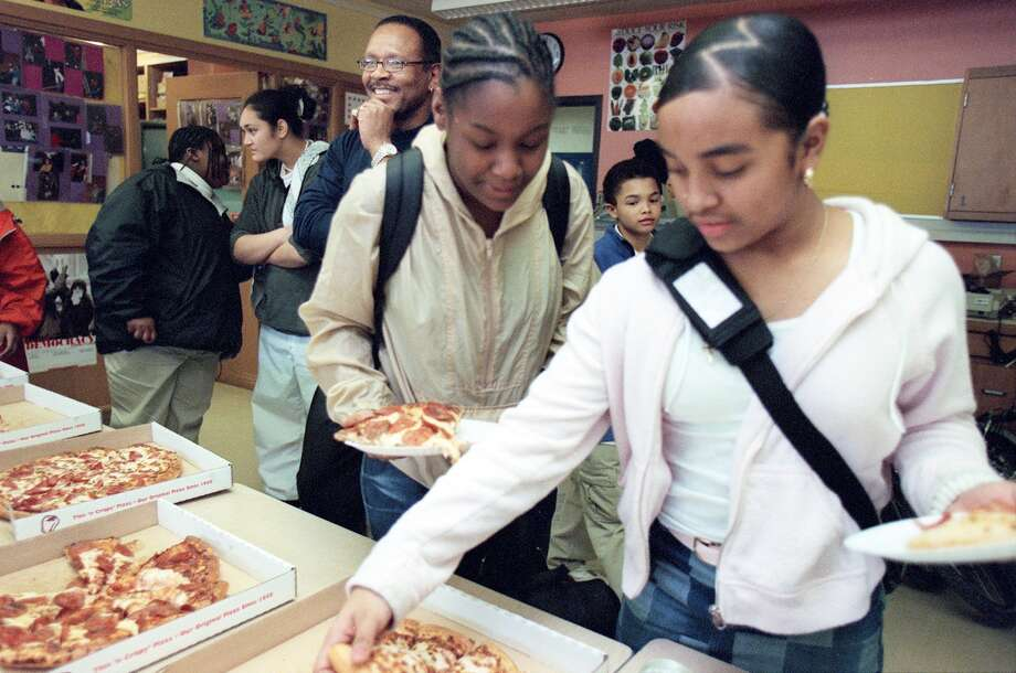 Always popular at school? Pizza. Nathan Hale guidance counselor Jacob Ellis had invited Madrona Elementary students on March 5, 2002, to help recruit minority students to the north-end school. He offered a school tour and pizza.  Photo: PAUL JOSEPH BROWN, Copyright MOHAI