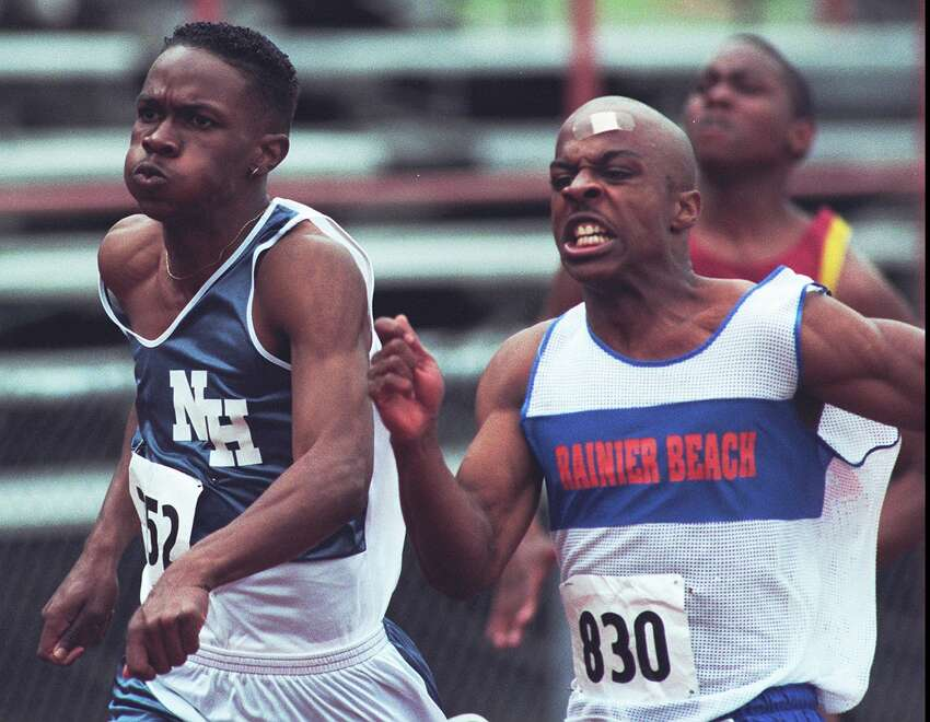 Antomio Conley of Rainier Beach high school is elbow to elbow with Johnnie Williams from Nathan Hale in the 100m Dash at the 1996 Sea-King AA District Track and Field Championships held at the Shoreline Stadium, Friday 5-17-96 Photographer:Loren Callahan