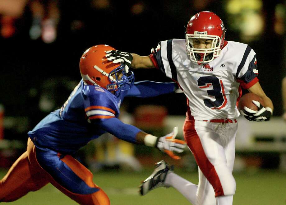 Nathan Hale running back Marco Henry can't stiff-arm his way out of a four-yard loss as he is brought down by Rainier Beach's Najee Ali behind the line of scrimmage on Oct. 10, 2008.  Photo: Scott Eklund, Copyright MOHAI / Seattle Post-Intelligencer