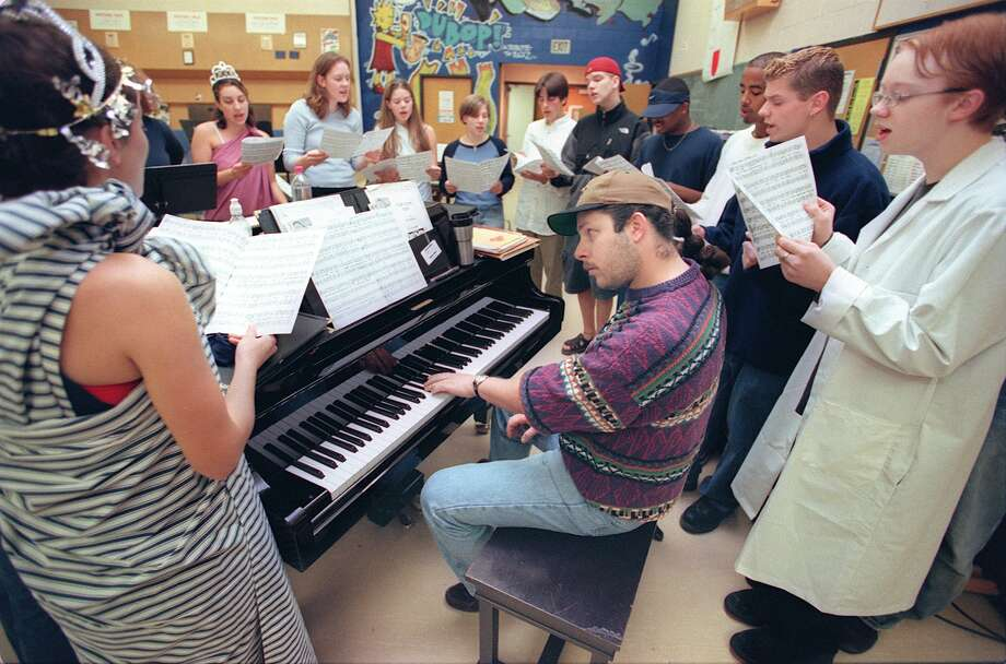 Rich Sumstad leads a rehearsal of the Nathan Hale High School Jazz Chorus in 1999, when the group was selected to perform in Carnegie Hall.  Photo: PAUL JOSEPH BROWN, Copyright MOHAI