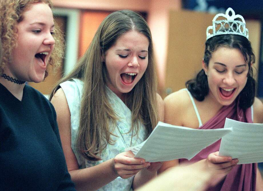 Lauren Dixon, Sarah Ross and Adrianne Banner are pictured in 1999, during a rehearsal of Nathan Hale High School's Jazz Chorus.  Photo: PAUL JOSEPH BROWN, Copyright MOHAI