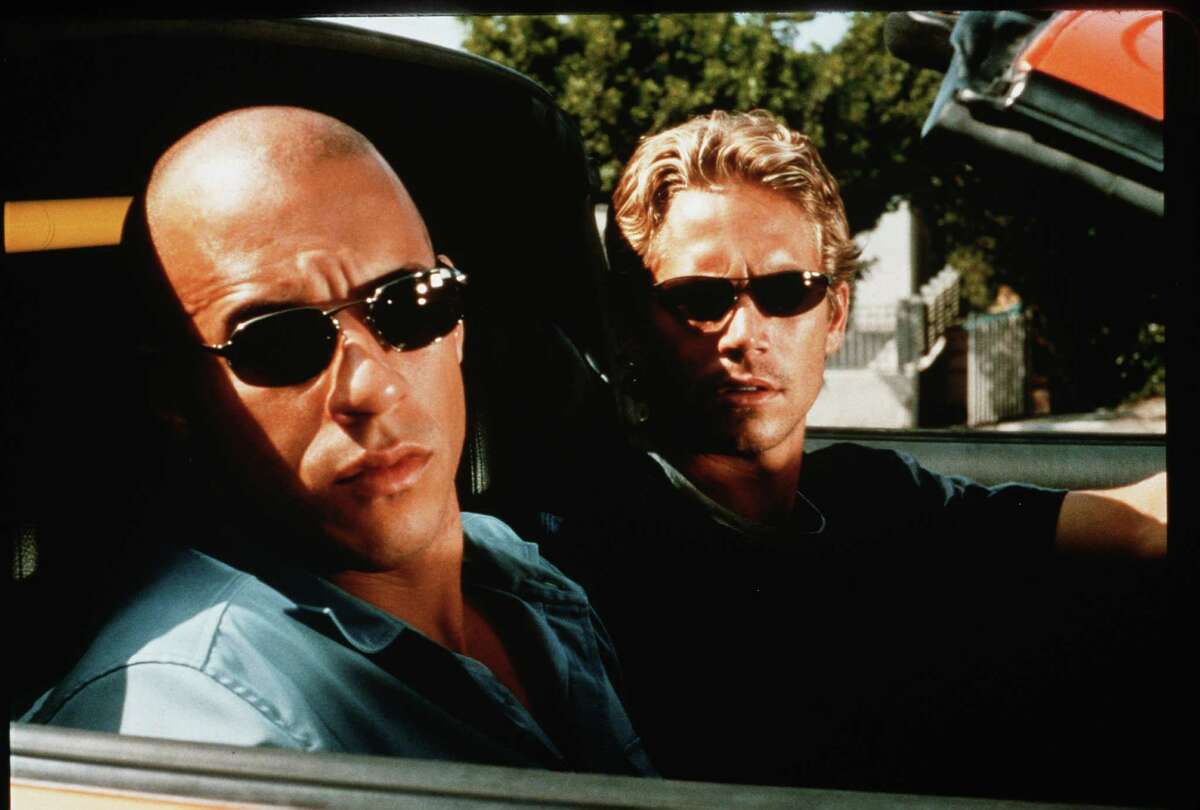 """Vin Diesel, left, and Paul Walker star in """"The Fast and the Furious."""" The film, and the late Walker, will be honored Saturday at the Houston Raceway."""