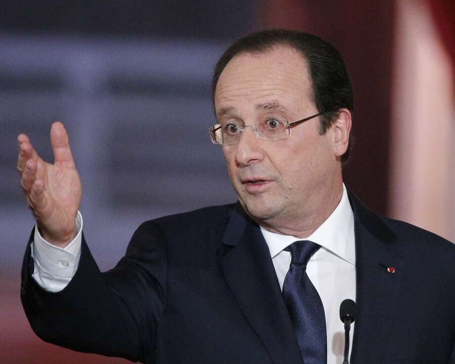 President Francois Hollande answers a reporter's question during a news conference in Paris. Photo: Christophe Ena, Associated Press