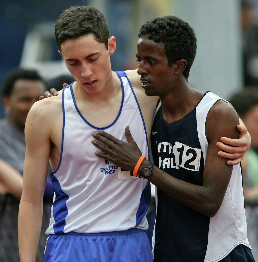 Nathan Hale has had many star athletes over the years, including runner Abdi Hassan (right), who was a state champ in the 800- and 1,600-meter runs in 2007. He's pictured after his 1,600-meter win on May 18, 2007, when he beat Seattle Prep's Max O'Donoghue-McDonald, left.  Photo: Mike Urban, Copy MOHAI / Seattle Post-Intelligencer