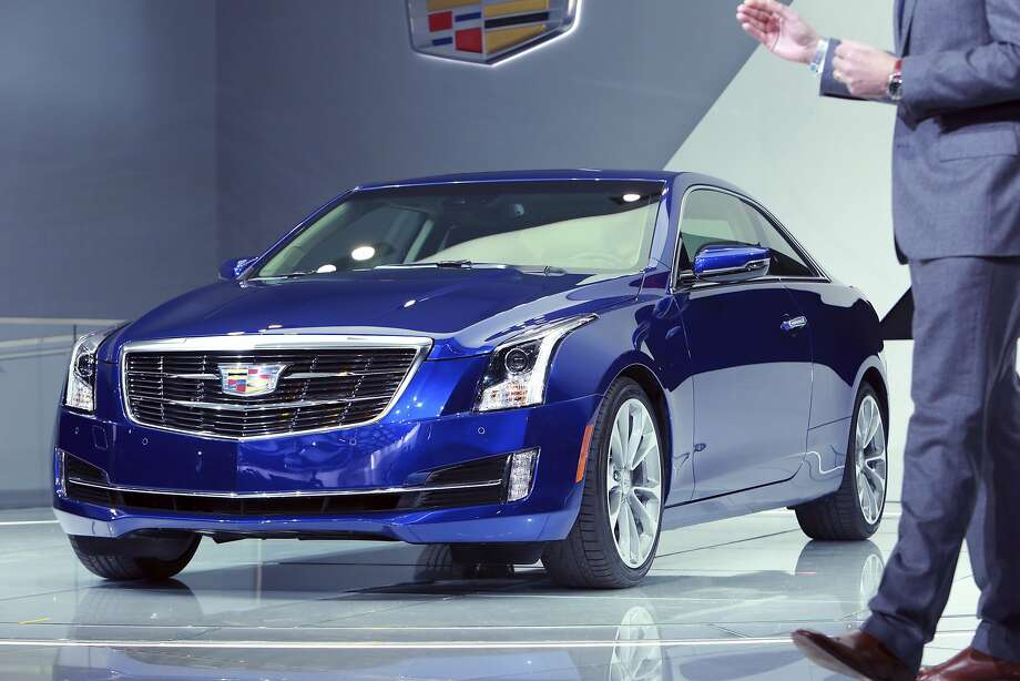 Cadillac ATS coupe:General Motors' Cadillac brand gets another tool to go after the Germans with the sleek new 2015 ATS Coupe. Aimed at the BMW 4-Series and Audi A5, the ATS coupe offers the same engines, transmissions and most of the same features as the sedan. But the coupe gets its own roof, doors, front fascia and fenders to accommodate a wider track than the sedan. The coupe, unveiled Tuesday at the Detroit auto show, is expected to arrive in showrooms during the summer. The car will likely cost more than the current sedan, which starts at $33,065 excluding shipping.  Photo: Fabrizio Costantini, New York Times
